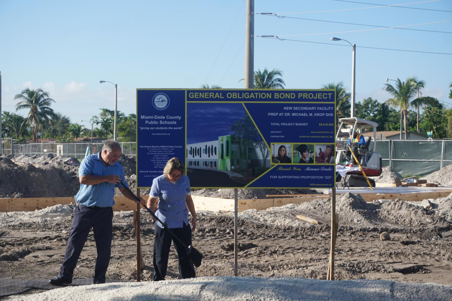 Custodians Jesus Diaz and Marvelia Mansur lay the sand on the site of the iPrep construction zone in preparation for the ceremonial groundbreaking on Monday, Nov. 6, 2017. MDCPS district officials joined Superintendent of Schools Alberto Carvhalo and Krop faculty and students to unveil the beginning of construction of the new academy.