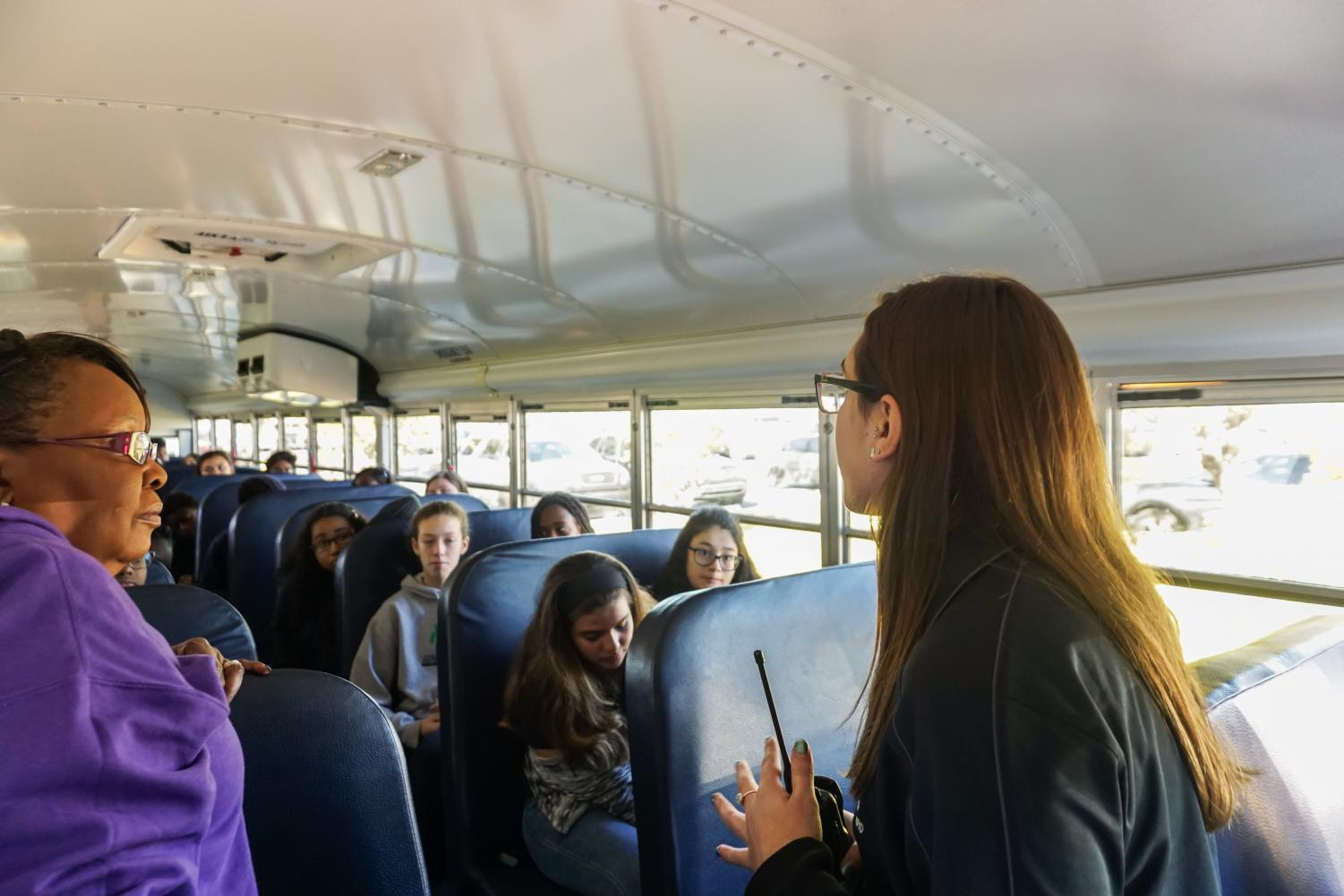 Student Government Association (SGA) Vice President Ariel Hartzy greets a bus of eighth graders from Highland Oaks Middle School in the teacher parking lot on December 15, 2017 for Lightning for a Day. Highland Oaks Middle brought the most students to the event.