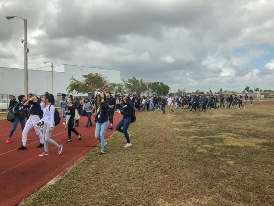 Students+walk+the+track+in+support+of+gun+control+reform+as+a+part+of+the+%22walk-out%22+movement%2C+which+aims+to+bolster+support+for+gun+control.+More+than+two-hundred+students+circled+the+track+starting+at+noon+on+Feb.+21.