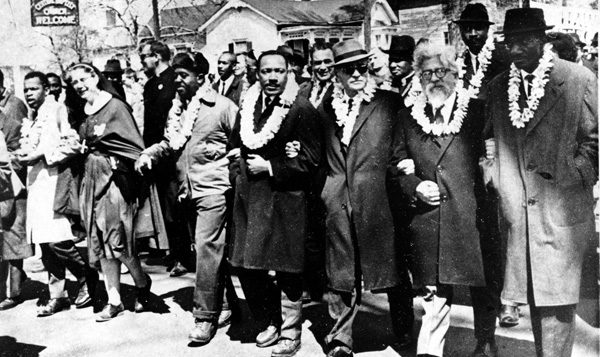 Dr. Martin Luther King Jr., center, and Rabbi Abraham Joshua Heschel, second from right, march in Selma. The Selma-to-Montgomery march was held in 1965.